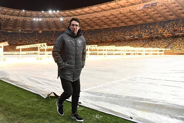 Unai Emery inspects the pitch at the stadium in Poltava before the match was moved (Getty)