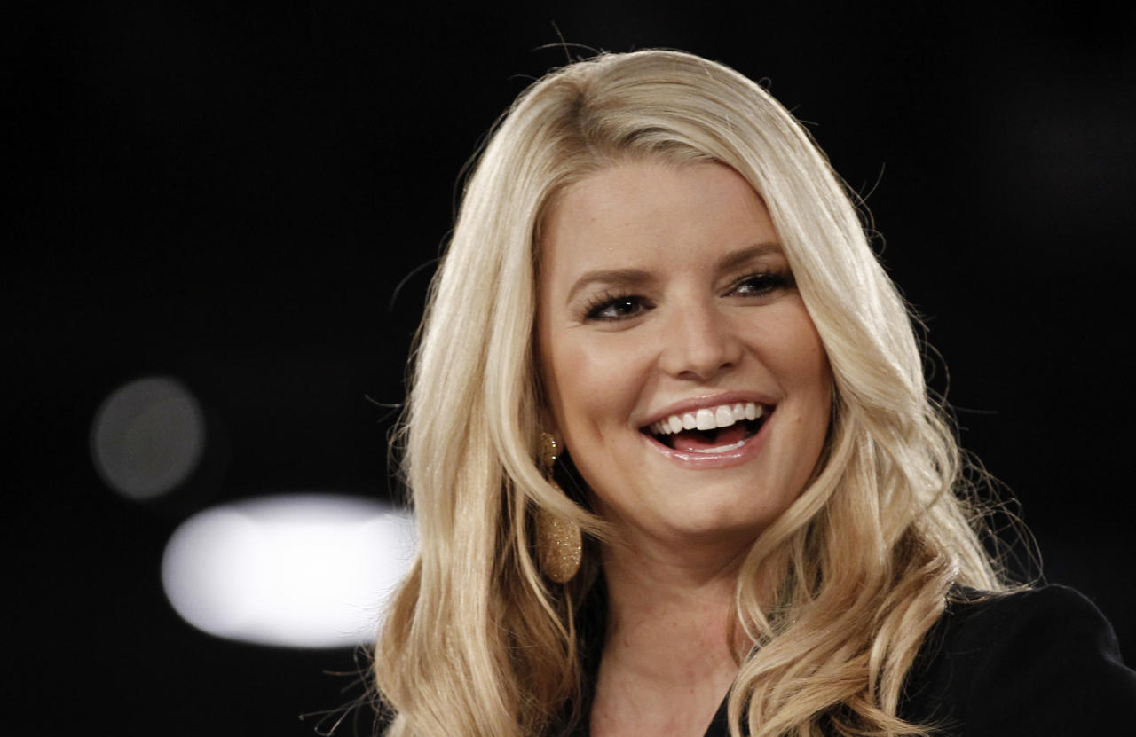 Jessica Simpson speaks onstage at Night at the Village during the Women's Conference in Long Beach, Calif., Monday, Oct. 25, 2010.