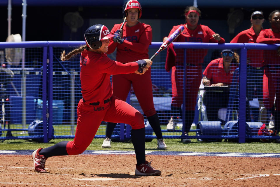 United States' Amanda Chidester watches her game winning hit in the eight inning of a softball game against Australia at the 2020 Summer Olympics, Sunday, July 25, 2021, in Yokohama, Japan. (AP Photo/Sue Ogrocki)