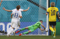 Slovakia's goalkeeper Martin Dubravka makes a save during the Euro 2020 soccer championship group E match between Sweden and Slovakia, at the Saint Petersburg stadium, in Saint Petersburg, Russia, Friday, June 18, 2021. (Anatoly Maltsev, Pool via AP)