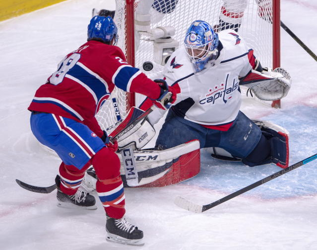 Montreal Canadiens defenseman Mike Reilly (28) scores the first goal against Washington Capitals goaltender Pheonix Copley (1) during first period NHL hockey action Monday, Nov. 19, 2018 in Montreal. (Ryan Remiorz/The Canadian Press via AP)
