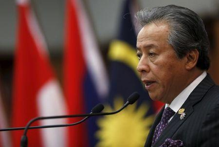 Malaysia's Foreign Minister Anifah Aman speaks to the media after the foreign ministers' meeting at the 26th ASEAN Summit in Kuala Lumpur, Malaysia