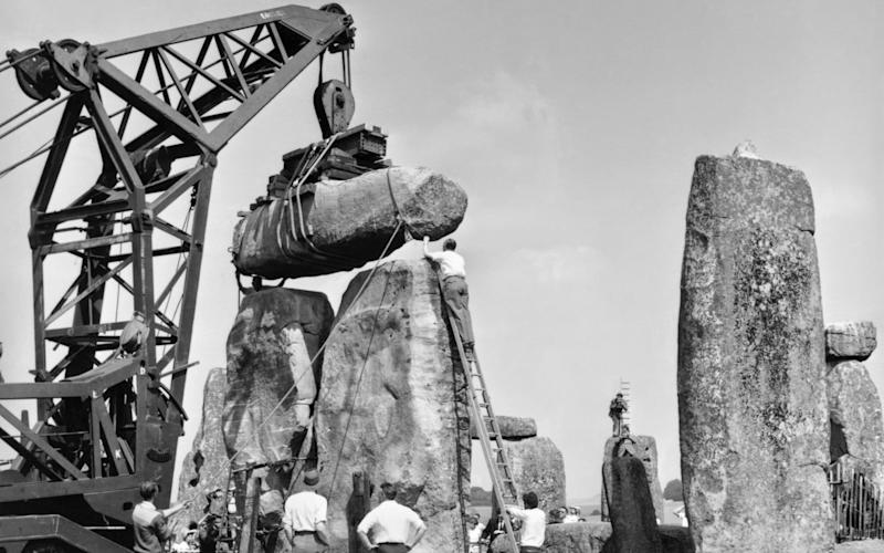 Making repairs to Stonehenge in 1920 - English Heritage. NMR