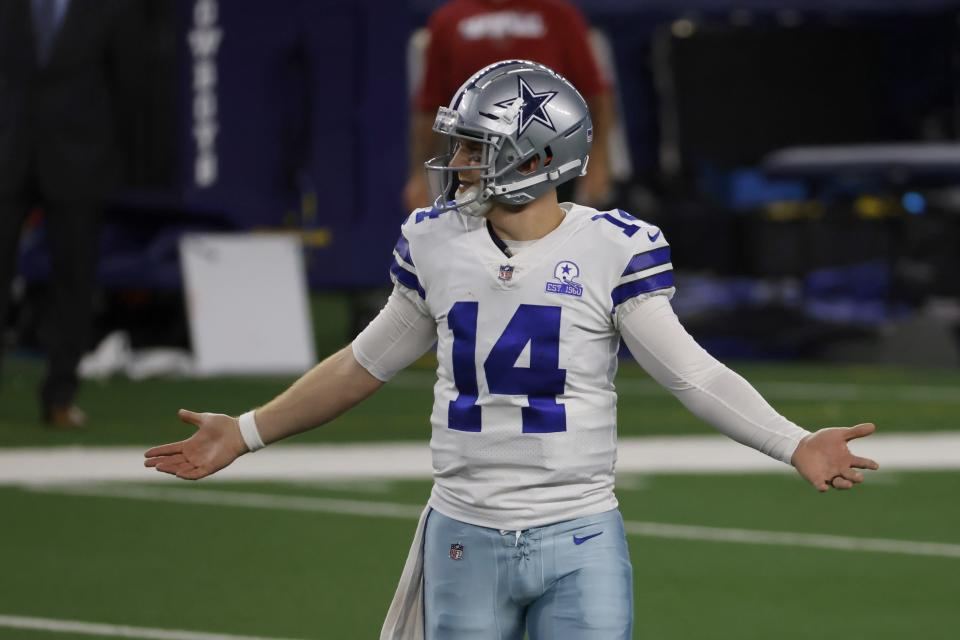 Dallas Cowboys quarterback Andy Dalton (14) gestures after throwing an interception in the second half of an NFL football game against the Arizona Cardinals in Arlington, Texas, Monday, Oct. 19, 2020. (AP Photo/Ron Jenkins)