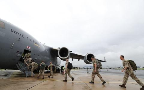 Soldiers board a Royal Air Force C-17 Globemaster III aircraft at Brize Norton, Oxfordshire, before they are flown to help out in the areas affected by Hurricane Irma as winds of up to 175mph left death and destruction in the Atlantic - Credit: PA