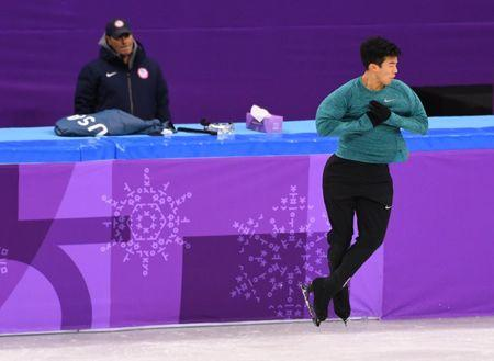 Feb 13, 2018; Gangneung, South Korea; Nathan Chen is watched by coach Rafael Arutyunyan during figure skating training for the Pyeongchang 2018 Olympic Winter Games at Gangneung Curling Centre. Mandatory Credit: Robert Deutsch-USA TODAY Sports