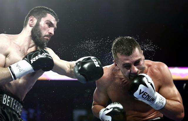 Artur Beterbiev (L) and Oleksandr Gvozdyk compete in a light heavyweight world title unification boxing fight at the Liacouras Center in Philadelphia. (Getty Images)