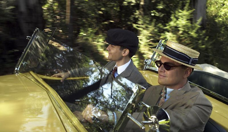 """This film publicity image released by Warner Bros. Pictures shows Tobey Maguire as Nick Carraway and Leonardo DiCaprio as Jay Gatsby in a scene from """"The Great Gatsby."""" (AP Photo/Warner Bros. Pictures)"""