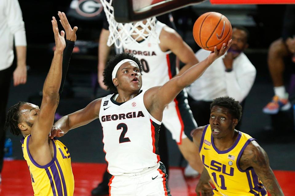 Georgia's Sahvir Wheeler (2) takes a shot while being defended by LSU guard Javonte Smart (1) and LSU forward Josh LeBlanc Sr. (11) during an NCAA basketball game between Georgia and LSU in Athens, Ga., on Tuesday, Feb 23, 2021. (Photo/Joshua L. Jones, Athens Banner-Herald)