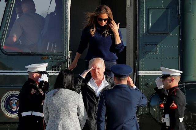 <p>President Donald Trump salutes as he and first lady Melania Trump arrive to board Air Force One for travel to Puerto Rico, to survey hurricane damage, from Joint Base Andrews, Md., Oct. 3, 2017. (Photo: Jonathan Ernst/Reuters) </p>