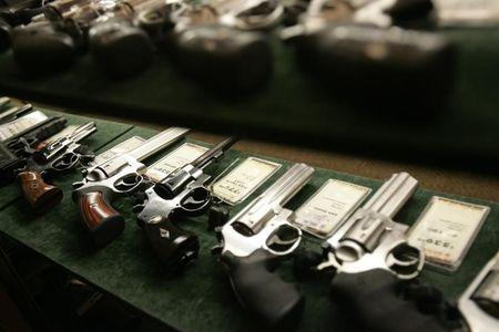 Guns are seen inside a display case at the Cabela's store in Fort Worth