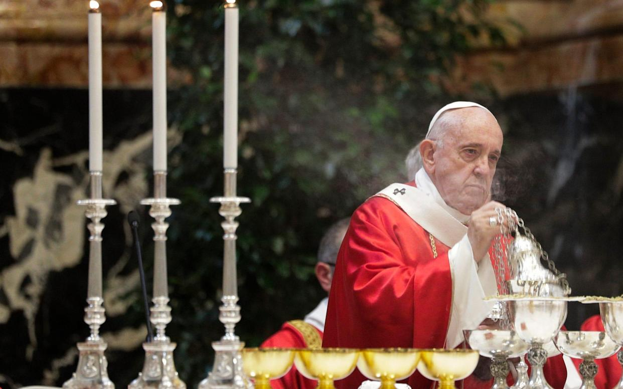 Pope Francis celebrates a Mass for cardinals and bishops who died in the past year, in St. Peter's Basilica at the Vatican, Nov. 4, 2019 - AP