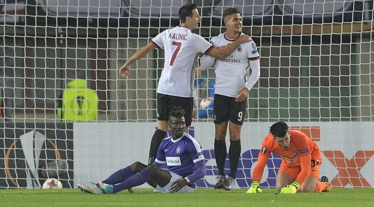 Milan's forwards Nikola Kalinic (L) and Andre Silva celebrate the second goal during the UEFA Europa League group D football match against FK Austria Wien in Vienna, Austria on September 14, 2017