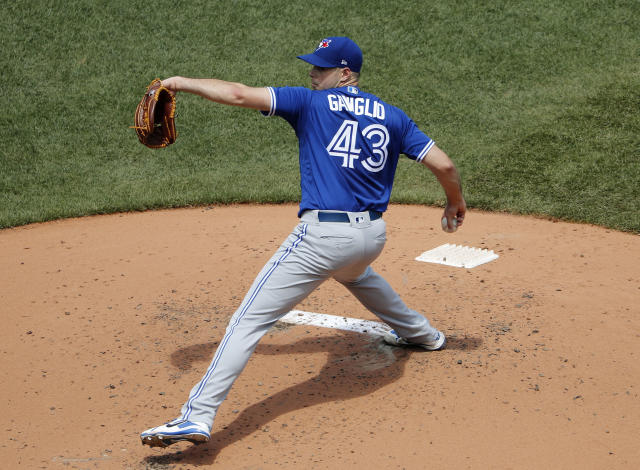 Toronto Blue Jays' Sam Gaviglio delivers against the Boston Red Sox during the first inning of a baseball game Saturday, July 14, 2018, in Boston. (AP Photo/Winslow Townson)