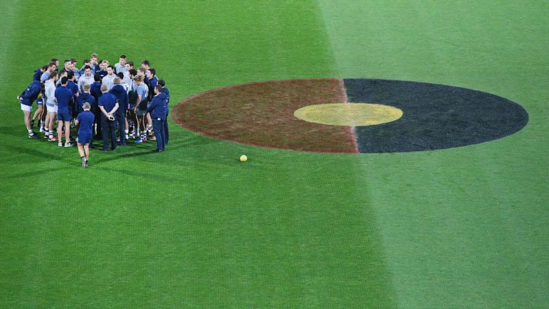The Aboriginal flag can be seen here painted on the centre circle for an AFL match.
