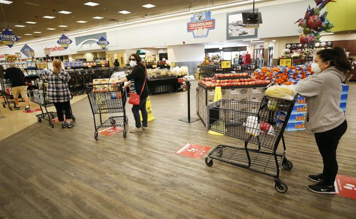 """<span class=""""caption"""">Who will wait on the checkout line footprints and who will rage against them?</span> <span class=""""attribution""""><a class=""""link rapid-noclick-resp"""" href=""""https://www.gettyimages.com/detail/news-photo/vons-shopper-maintain-safe-distance-in-the-checkout-line-at-news-photo/1212798930"""" rel=""""nofollow noopener"""" target=""""_blank"""" data-ylk=""""slk:Al Seib/Los Angeles Times via Getty Images"""">Al Seib/Los Angeles Times via Getty Images</a></span>"""