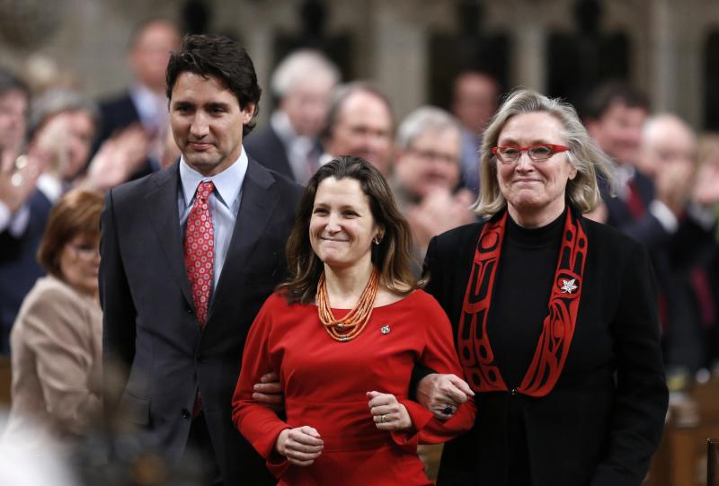 Liberal leader Trudeau and MP Bennett escort recently elected MP Freeland in the House of Commons on Parliament Hill in Ottawa