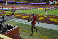 Tampa Bay Buccaneers wide receiver Chris Godwin (14) celebrating his touchdown against the Washington Football Team during the first half of an NFL wild-card playoff football game, Saturday, Jan. 9, 2021, in Landover, Md. (AP Photo/Julio Cortez)