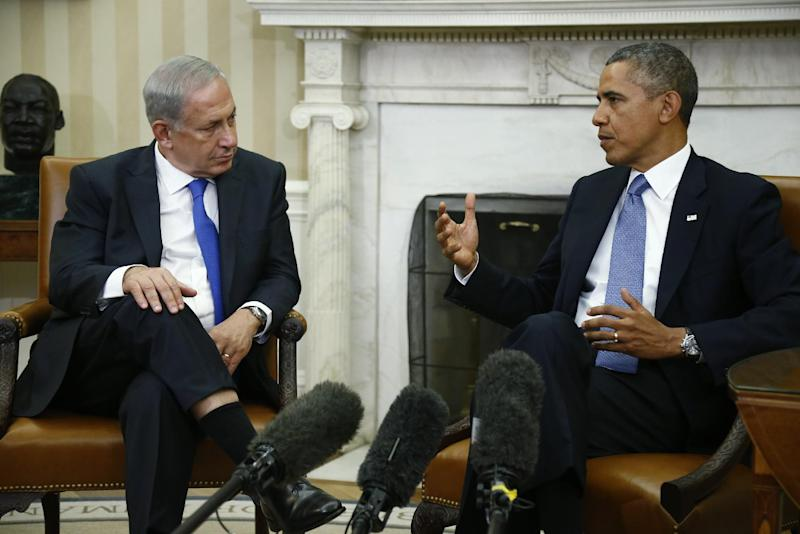 File - In this Sept. 30, 2013, file photo, President Barack Obama meets with Israeli Prime Minister Benjamin Netanyahu in the Oval Office at the White House in Washington. The U.S. and Iran secretly engaged in high-level, face-to-face talks, at least three times over the past year, in a high stakes diplomatic gamble by the administration that paved the way for the historic deal aimed at slowing Iran's nuclear program. After the Sept. 27, phone call between Obama and Iranian president Hassan Rouhani, the U.S. began informing allies about the talks. Obama handled the most sensitive conversation himself, briefing Netanyahu during his Sept. 30 visit to the White House. Israel remains furious about the agreement. (AP Photo/Charles Dharapak)