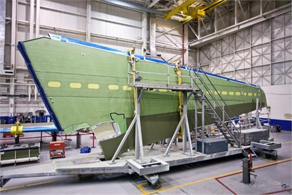 A Gulfstream wing being manufactured in a hangar.