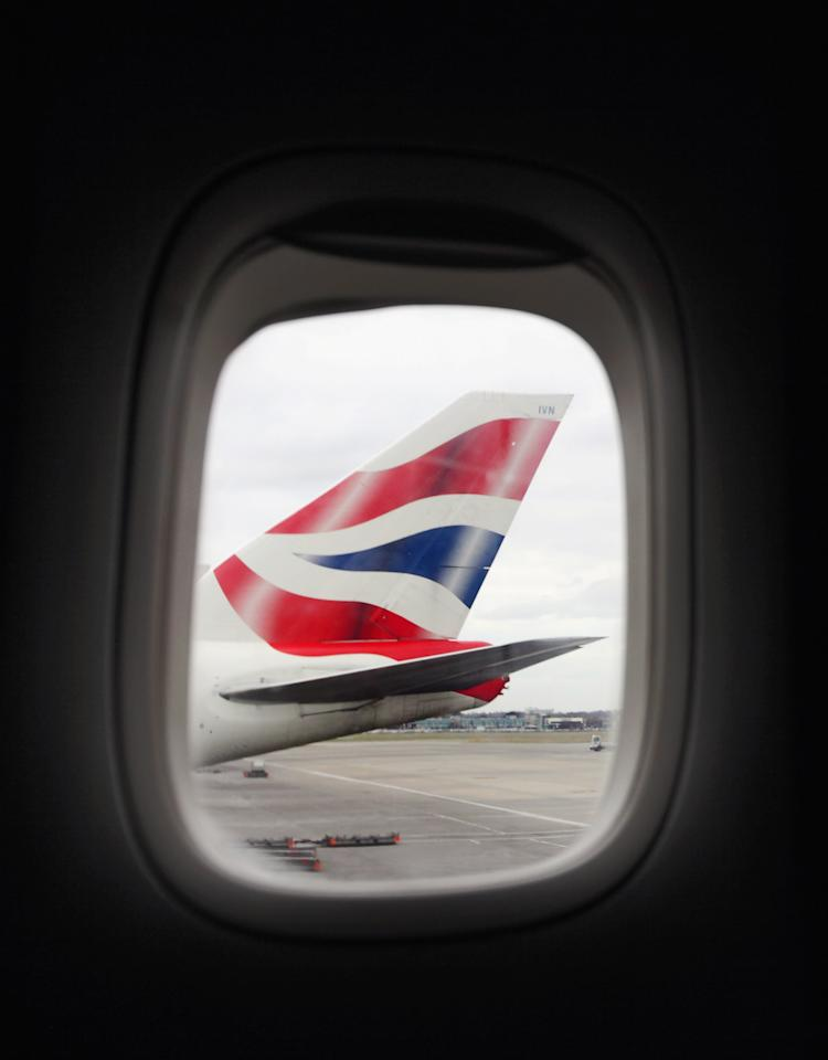 LONDON, ENGLAND - FEBRUARY 21: The tail-fin of a British Airways Boeing 747 aircraft is seen through the window of an adjacent plane at Heathrow airport's Terminal 5 on February 21, 2012 in London, England. Heathrow is the UK's largest airport with 89 airlines serving 176 different destinations in 90 countries around the world; in 2010 it handled 65.7 million passengers on over 449,000 flights. (Photo by Oli Scarff/Getty Images)