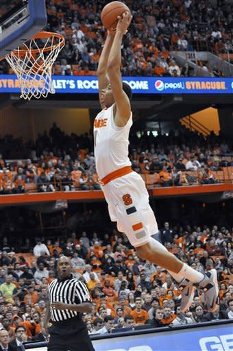 Syracuse's Michael Carter-Williams dunks against Monmouth during the second half of an NCAA college basketball game in Syracuse, N.Y., Saturday, Dec. 8, 2012. Syracuse won 108-56. (AP Photo/Kevin Rivoli)