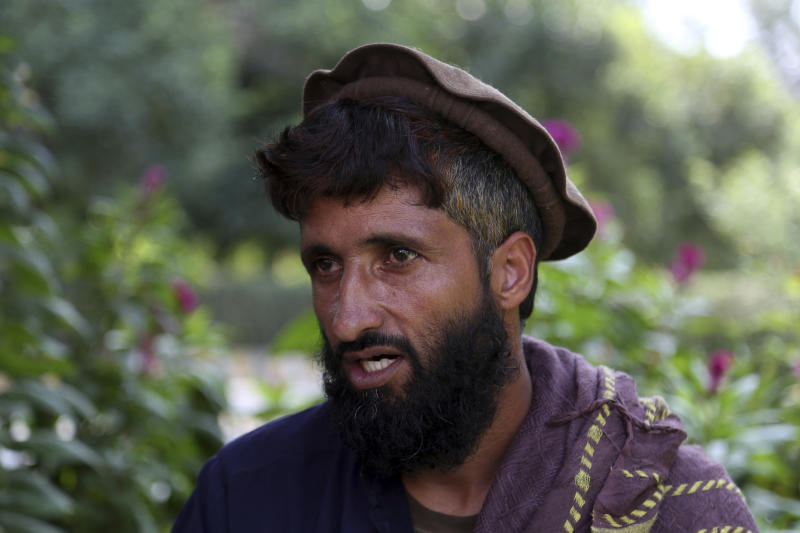 In this Tuesday, Oct. 1, 2019, photo, Abdul Jabar, who lost four members of his family, speaks during an interview to the Associated Press in Jalalabad city east of Kabul, Afghanistan,  Anger is mounting over the increasing numbers of civilians dying in misdirected US aerial strikes and heavy- handed tactics of CIA-trained Afghan force. Some Afghans calling for Americans to be tried in Afghan courts. (AP Photo/Rahmat Gul)