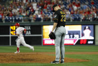Pittsburgh Pirates starting pitcher Mitch Keller, right, reacts after giving up a home run to Philadelphia Phillies' Corey Dickerson during the fifth inning of a baseball game, Wednesday, Aug. 28, 2019, in Philadelphia. (AP Photo/Matt Slocum)