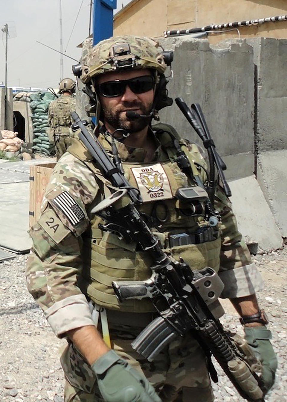 In this undated photo provided by Ryan Brummond, U.S. Special Forces Officer Ryan Brummond is seen in Afghanistan. Mohammad Khalid Wardak or Khalid, as he's called by his friends, had no intention of leaving Afghanistan, where he was a high-profile national police officer who'd worked alongside Brummond and American special forces to defeat the Taliban. Then with stunning speed, his government collapsed. Now he is in hiding with his wife and four children, wounded and hunted by the Taliban, desperately hoping that American officials will repay his loyalty by helping his family escape almost certain death. (Ryan Brummond via AP)