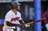 Cleveland Indians' Eddie Rosario watches his RBI double during the first inning of the team's baseball game against the Cincinnati Reds, Saturday, May 8, 2021, in Cleveland. (AP Photo/Tony Dejak)