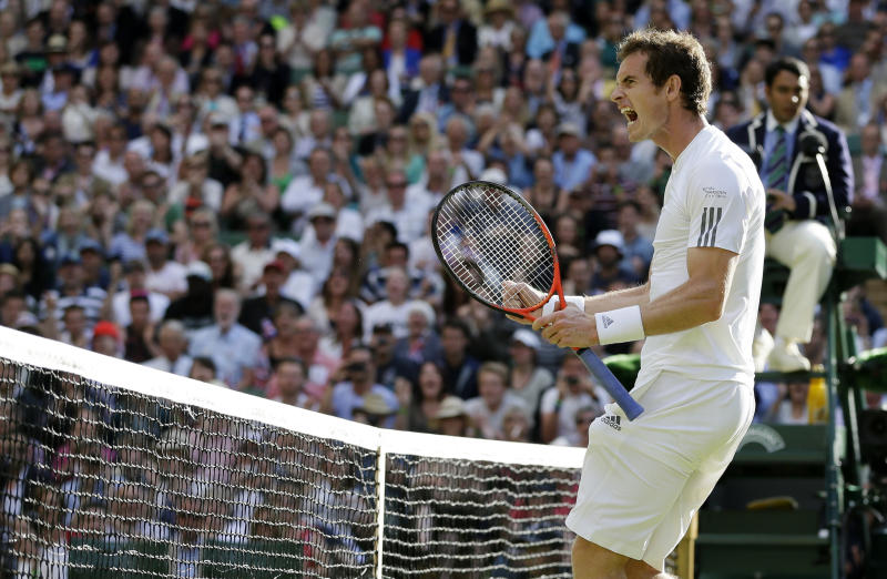 Andy Murray of Britain reacts as he defeats Mikhail Youzhny of Russia in a Men's singles match at the All England Lawn Tennis Championships in Wimbledon, London, Monday, July 1, 2013. (AP Photo/Alastair Grant)