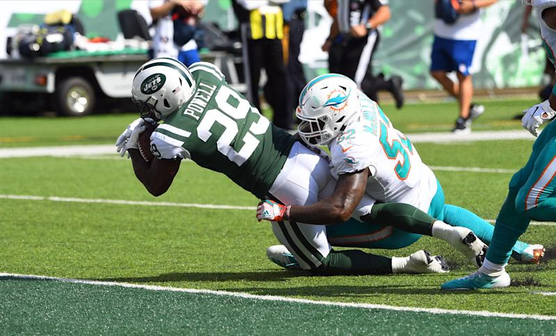 Sep 16, 2018; East Rutherford, NJ, USA; New York Jets running back Bilal Powell (29) scores a second half touchdown as Miami Dolphins linebacker Raekwon McMillan (52) defends at MetLife Stadium. Mandatory Credit: Robert Deutsch-USA TODAY Sports
