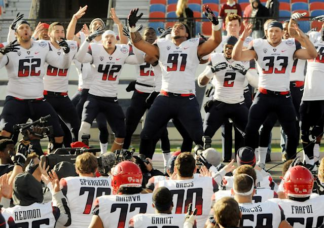 Arizona players do a victory dance after they defeated Boston College 42-19 in the AdvoCare V100 Bowl NCAA college football game Tuesday, Dec. 31, 2013, in Shreveport, La. (AP Photo/The Shreveport Times, Henrietta Wildsmith)
