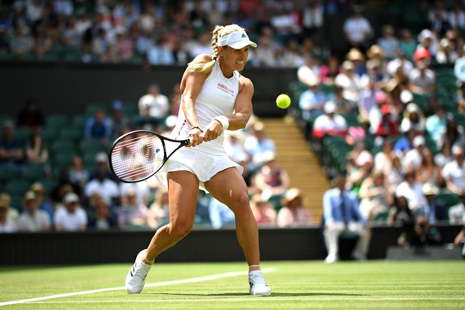 Angelique Kerber of Germany plays a backhand in her Ladies' Singles first round match against Tatjana Maria of Germany during Day two of The Championships - Wimbledon 2019 at All England Lawn Tennis and Croquet Club on July 02, 2019 in London, England. (Photo by Matthias Hangst/Getty Images)