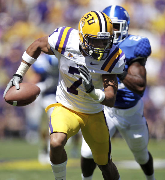 FILE - In this Oct. 1, 2011, file photo, LSU cornerback Tyrann Mathieu (7) returns a fumble for a touchdown as Kentucky running back Josh Clemons (20) pursues during the third quarter of an NCAA college football game in Baton Rouge, La. LSU has dismissed Heisman Trophy finalist Mathieu from its football program for violating school and team rules. At a news conference Friday, Aug. 10, 2012, coach Les Miles would not specify the reason Mathieu was kicked off the team. (AP Photo/Gerald Herbert, File)