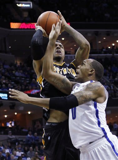 Southern Mississippi guard Maurice Bolden, top, goes to the basket against Memphis forward Ferrakohn Hall (0) in the first half of an NCAA college basketball game Wednesday, Jan. 11, 2012, in Memphis, Tenn. (AP Photo/Lance Murphey)