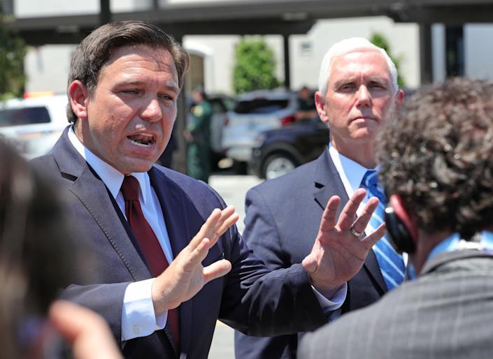 Florida governor Ron DeSantis answers reporters questions with Vice President Mike Pence at the Westminster Baldwin Park retirement community, in Orlando, Fla., Wednesday, May 20, 2020. Pence and  DeSantis visited the facility to assist in delivering PPE supplies in response to the coronavirus crisis. (Joe Burbank/Orlando Sentinel/Tribune News Service via Getty Images)