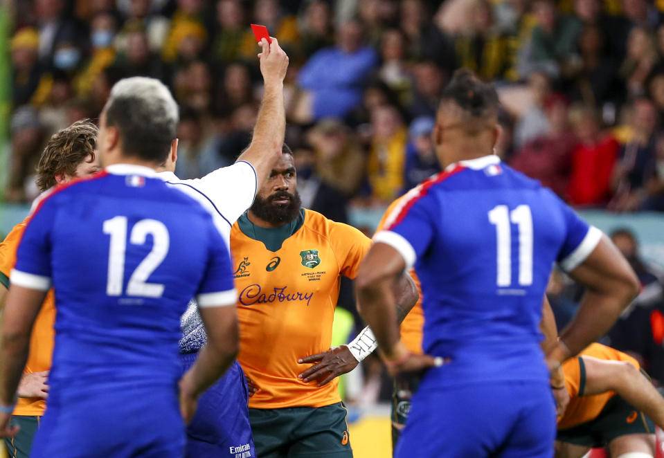 Australia's Marika Koroibete is shown a red card by referee Ben O'Keeffe during the third rugby international between France and Australia at Suncorp Stadium in Brisbane, Australia, Saturday, July 17, 2021. (AP Photo/Tertius Pickard)