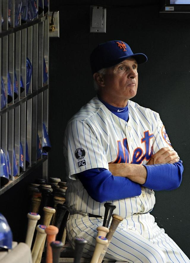 New York Mets manager Terry Collins looks out to the field from the dugout before the baseball game against the Philadelphia Phillies at Citi Field on Saturday, Aug. 30, 2014, in New York. (AP Photo/Kathy Kmonicek)