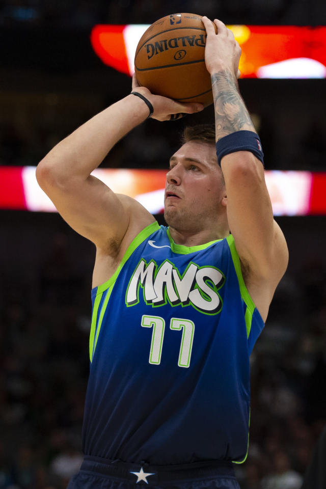 Dallas Mavericks forward Luka Doncic (77) shoots the ball during the second quarter of an NBA basketball game against the New Orleans Pelicans Saturday, Dec. 7, 2019 in Dallas. (AP Photo/Sam Hodde)