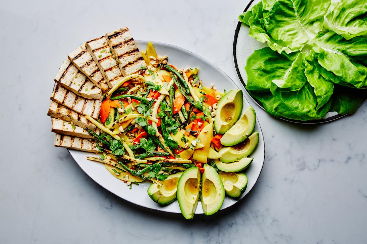 """Green beans and yellow wax beans form the bases of this refreshing, tangy, Thai-inspired salad. Grilled tofu and creamy avocado add filling protein and healthy fats, rounding out the meal. <a href=""""https://www.epicurious.com/recipes/food/views/grilled-thai-green-bean-salad?mbid=synd_yahoo_rss"""">See recipe.</a>"""