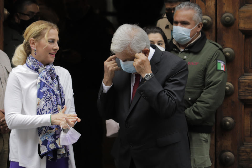 Andrés Manuel López Obrador, President of Mexico, removes his face mask outside the Museum of the Ministry of Finance and Public Credit located in the Zócalo of Mexico City, after casting his vote that will define the incumbents of the 16 mayoralties, 160 councilors and 66 seats in the Congress of Mexico City, as well as for the first time a migrant deputy.  (Photo by Gerardo Vieyra/NurPhoto via Getty Images)