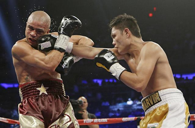 Marvin Sonsona, of the Philippines, punches Wilfredo Vazquez, of Puerto Rico, during the first ninth round of a NABF Featherweight Title boxing match Saturday, June 7, 2014, in New York. Sonsoma won the fight by split decision. (AP Photo/Frank Franklin II)