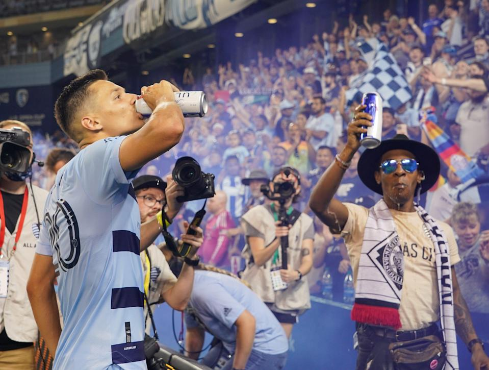 Sporting Kansas City's Daniel Salloi celebrates his team's win over the Colorado Rapids by drinking a beer.