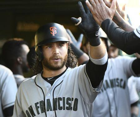 May 26, 2018; Chicago, IL, USA; San Francisco Giants shortstop Brandon Crawford (35) celebrates in the dugout after his two-run home run against the Chicago Cubs in the fourth inning at Wrigley Field. Mandatory Credit: Matt Marton-USA TODAY Sports