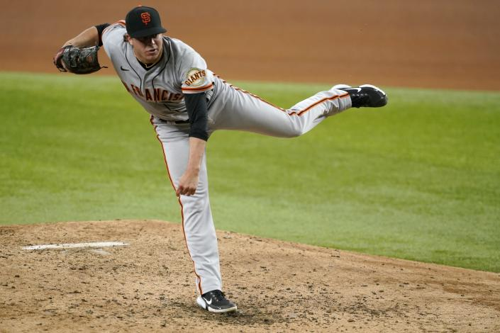 San Francisco Giants relief pitcher Sammy Long follows through on his delivery to the Texas Rangers in the fourth inning of a baseball game in Arlington, Texas, Wednesday, June 9, 2021. (AP Photo/Tony Gutierrez)