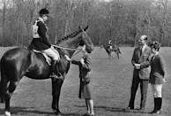 The Queen and Prince Philip talk to Prince Charles, mounted on a horse. The Prince of Wales turned 21 that year.