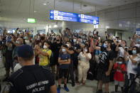 Fans of the NBA Champion Giannis Antetokounmpo, of the Milwaukee Bucks, who was named NBA Finals Most Valuable Player, cheer and take pictures at the Eleftherios Venizelos International Airport, in Athens, Greece, Sunday, Aug. 1, 2021. The NBA champion and finals MVP plans to stay in Greece for a few days, before returning to the U.S., where his girlfriend expects their second child later this month. (AP Photo/Michael Varaklas)