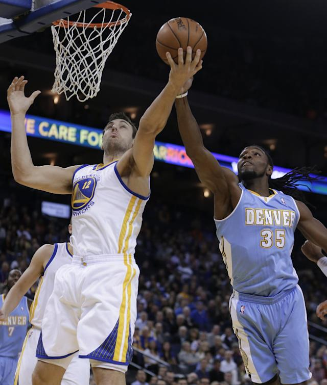 Denver Nuggets' Kenneth Faried, right, and Golden State Warriors' Andrew Bogut (12) reach for a rebound during the first half of an NBA basketball game on Wednesday, Jan. 15, 2014, in Oakland, Calif. (AP Photo/Ben Margot)