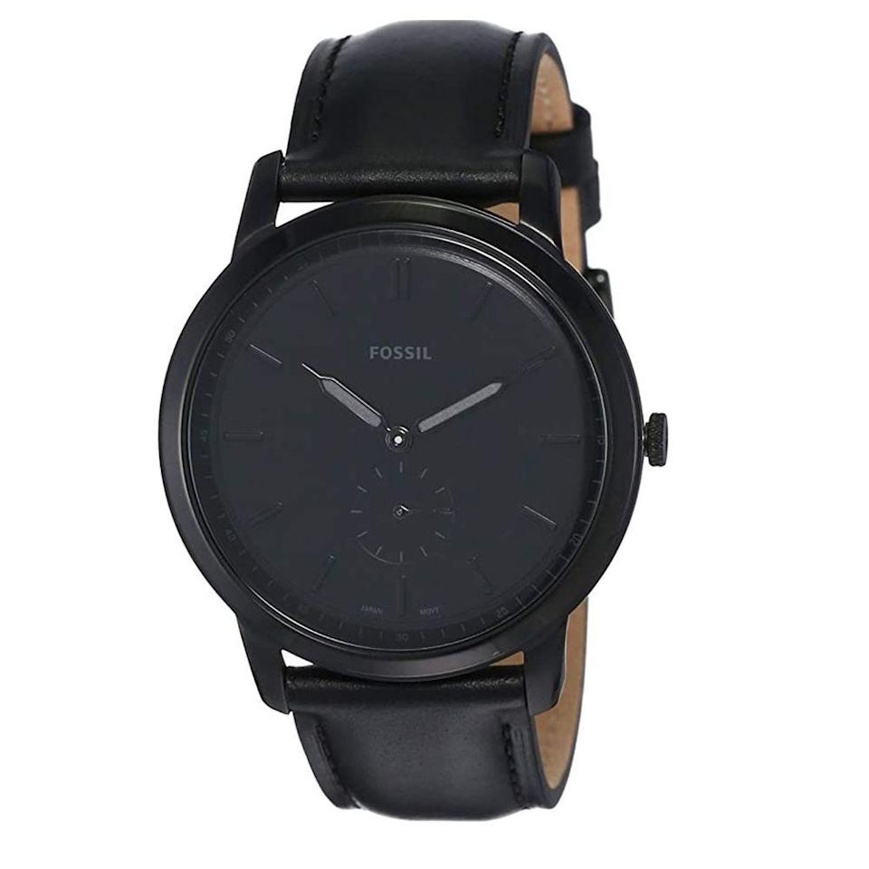 """<p><strong>Fossil</strong></p><p>amazon.com</p><p><a href=""""https://www.amazon.com/dp/B0872Z8CF6?tag=syn-yahoo-20&ascsubtag=%5Bartid%7C2139.g.36673991%5Bsrc%7Cyahoo-us"""" rel=""""nofollow noopener"""" target=""""_blank"""" data-ylk=""""slk:BUY IT HERE"""" class=""""link rapid-noclick-resp"""">BUY IT HERE</a></p><p>Struggling with your gift list? Fossil's matte black watch makes a great present: Take it to their nearest store for complementary engraving, for a personal touch anyone would love to receive for a birthday or holiday. </p>"""